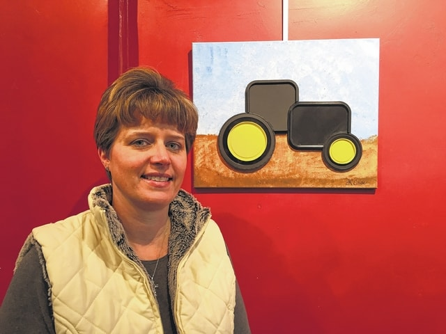 Lisa Case is a design engineer for Tech II, Inc. Although she took art classes in high school and college, she now enjoys playing golf and scrapbooking in her free time. Her artwork is a mixed media tractor constructed of plastic lids that she designed.