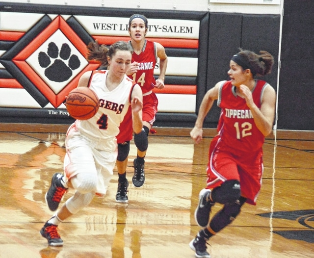 West Liberty-Salem's Gabby Hollar pushes the ball up the court against Tippecanoe earlier in the season. The Tigers will look to push the ball offensively and keep Madeira from doing the same in Saturday's district final.