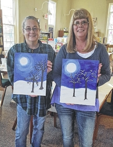 Penny Forman of Bellefontaine, left, and Lori Hill of North Lewisburg, display their paintings following a painting class at the North Lewisburg branch of the Champaign County Public Library on Jan. 30. The class was instructed by Betsy Woodruff of Blank Canvas Studio in Bellefontaine. The Friends of the North Lewisburg Branch Library provided a tea party during a break. More painting events will occur in the future at the North Lewisburg branch.