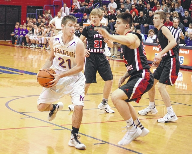 Mechanicsburg's Colton McMannis spins to face his defender down low and looks to score against Fort Loramie on Friday.