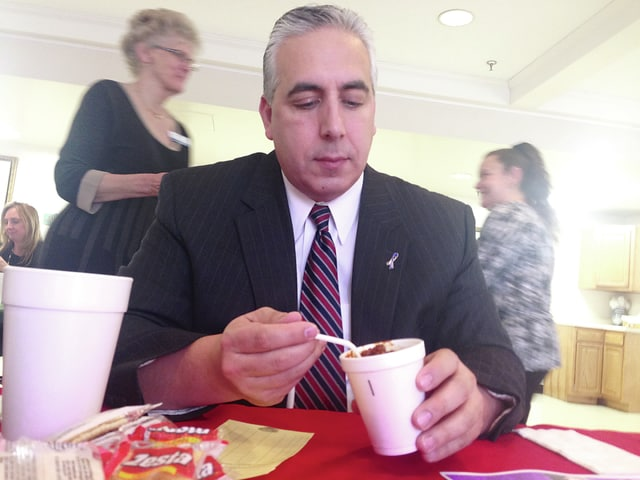 Champaign County Prosecutor Kevin Talebi prepares to taste a chili sample from the hot and spicy offerings during Thursday's Chili Cook-Off at Heartland of Urbana. The annual event is a prelude to the March 3 fundraiser.