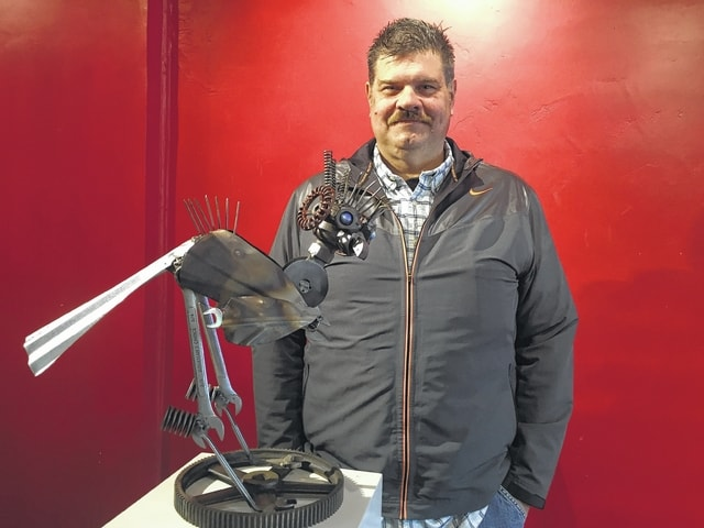"""David Bacher is the owner of Noreast Transport. Last year, he started the Rhythm & Foods Festival held at the Champaign County Fairgrounds. He enjoys """"hot rods"""" and industrial décor. His metal chicken sculpture was made from scrap pieces in his shop."""