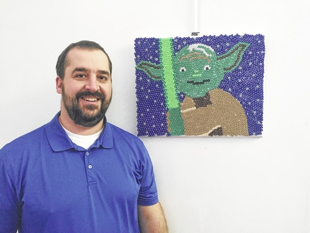 John Beard is a Network Administrator at Bundy Baking Solutions in Urbana. His daughters, Jessa and Alexa, and his wife, Shannan, helped him with his artwork.