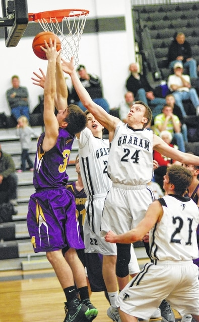 Mechanicsburg's David Harvey (3) goes up for a basket while Graham's Charles Baumgardner (24) tries to block the shot during Tuesday night's game at GHS.