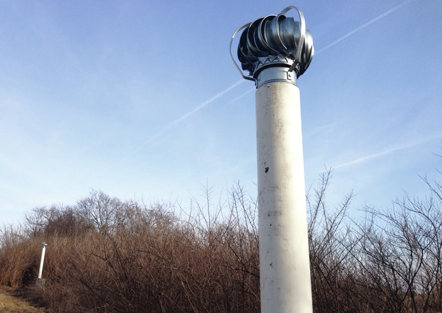 A turbine passive vent spins above ground at the old city landfill this week. The landfill closed in 1988, and the city had been monitoring and complying with EPA requirements to deal with issues associated with it. This includes putting a cap on it to fix any groundwater issues, Urbana Director of Administration Kerry Brugger said. The cap, however, trapped the methane in the landfill, rather than allowing it to be burned off, Brugger said.