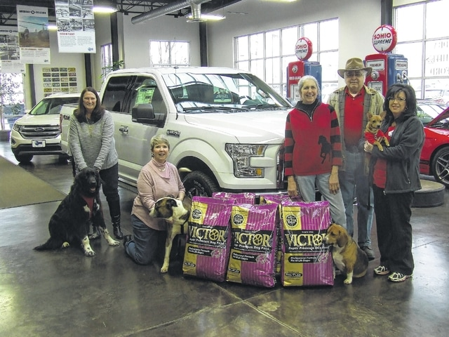Pictured from left are: Susie White with Prairie, White's Auto Group; Barb Faulkner with Capone from Top of Ohio Pet Shelter, Logan County; Connie Smith with Wilson from Barely Used Pets, Champaign County; Don Richardson and Jennifer Young with Brutus from PAWS Animal Shelter, Champaign County.
