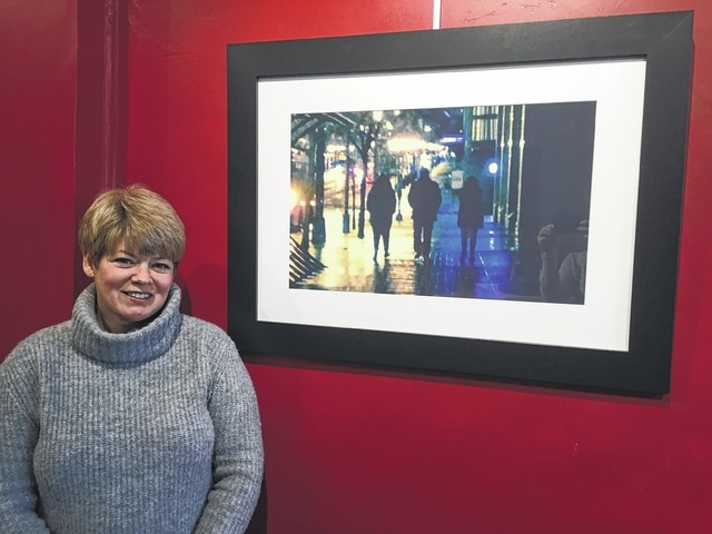 "Lori Reisinger is a judge for the Champaign County Family Court. She collects original cityscapes of downtown Columbus and commissioned a photo series of Champaign County to display in her courtroom. Her photograph is called ""Never Look Back"" and features her three children who go out into the world on new adventures without fear and never looking back for reassurance."