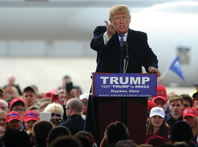 Mike Ullery | Daily Call Republican presidential candidate Donald Trump speaks to a crowd of thousands that turned out for a rally at the Dayton International Airport on Saturday, March 11.