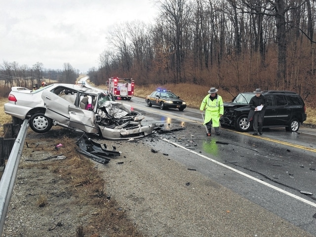 Investigators with the Champaign County Sheriff's Office are shown at the scene of a two-vehicle collision on U.S. Route 68 south of Hickory Grove Road on Tuesday.