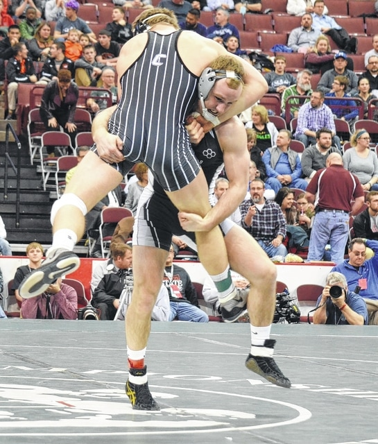 Graham's Alex Marinelli picks his opponent up and slams him to the mat during Saturday's finals match at 170 pounds. Marinelli claimed his fourth state title, joining an elite club.