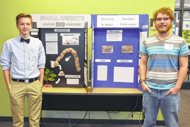 Urbana High School freshman Jaxton Bloemhard, left, and senior Robert Daniels, right, participated in the Champaign County Science Day at Urbana University. Daniels' project involved the use of electronics to modify the firing mechanism of an air-soft device. Bloemhard's project, about mealworms eating styrofoam, was awarded the highest score in the county. Both students received superior ratings, making them eligible to participate in the Upper Miami Valley District Science Day on Feb. 27 at Edison State Community College.