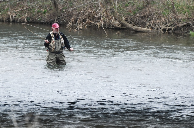 With numerous schools and factories on spring break, outdoors enthusiasts have been visiting their favorite recreational spots this week. Greg McGowan of Bellefontaine is pictured fishing along the U.S. Route 36 bridge on Thursday as the wind whipped up a storm. After a chilly Good Friday, warmer spring temperatures are returning for Easter weekend and beyond.