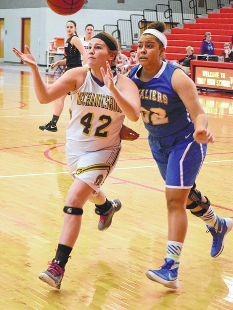 Mechanicsburg's Sydney Hux chases down a rebound in the corner during Friday's Division IV District 9 All-Star game at Troy High School.