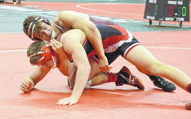 Urbana's Jack Harris works his man from the top position Friday during the Division II state wrestling tournament.
