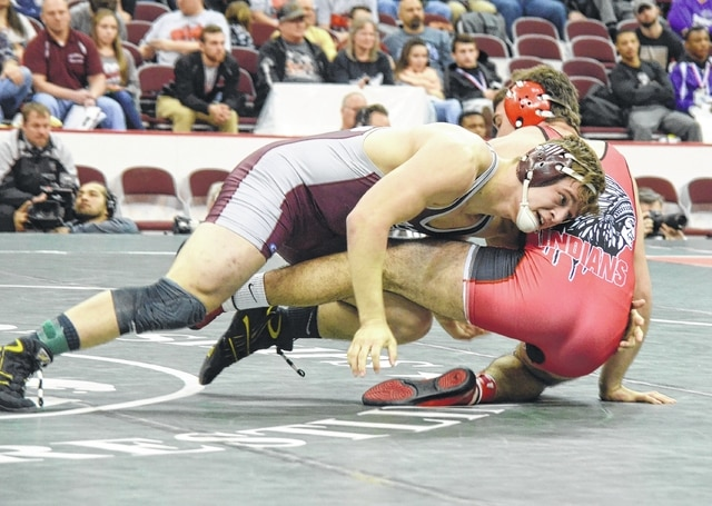 Urbana's Jack Harris drives his opponent to the ground Saturday night during the 195-pound bout of the Division II state wrestling championship. Harris is the first Hillclimber to win a title.