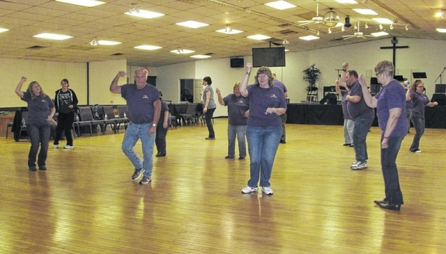 "Members of the ""Just For Fun Line Dancers"" and others learning to line dance show their skills March 10 at Life-Net Christian Fellowship Church in Urbana. Resident Jack Ferryman offers free line dancing lessons every Thursday at the church."
