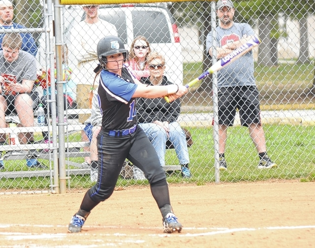 Urbana University's Margo Jackson swats a ball to the opposite field on Wednesday versus visiting West Liberty University.