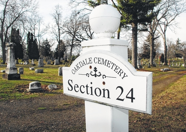 Pictured is a section marker at Oak Dale Cemetery in Urbana. On Monday, City Council heard the first reading of an ordinance that would establish a board to oversee operations at the cemetery, which first opened in 1856.