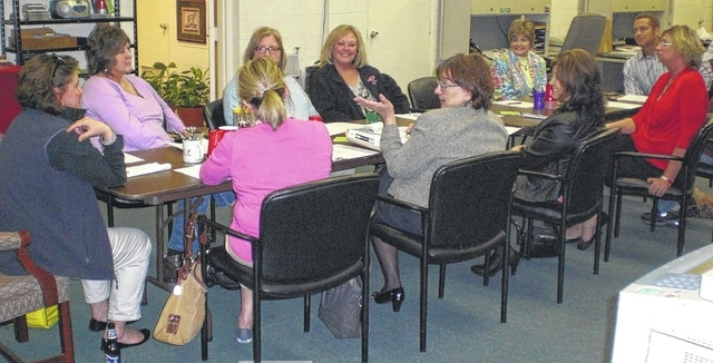 Committee members include, clockwise from left at head of table, Beth Adair, chair, Linda Monroe, Amy Chamberlain, Lori Williams, Sandy Gonzalez, Jeremiah Stocksdale, Jeff Heiberger, Amy Knotts, Sandy Loffing, Mary Collier and Carolyn Headlee.