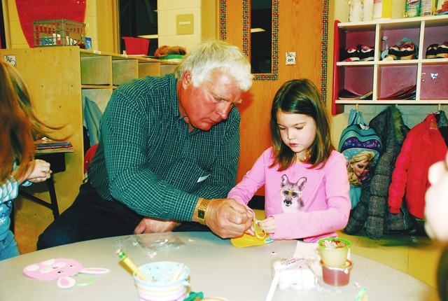 Jack Graham works on an Easter craft with his granddaughter, Paige Graham, during an event held on Thursday at Triad Elementary in celebration of March being National Reading Month. Paige is a student in Janet Mroczkowski's kindergarten class.