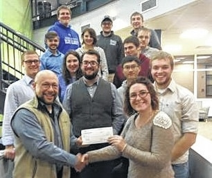 Ryan Levin of the Levin Family Foundation poses with members of the Urbana University Shooting Sports Club.