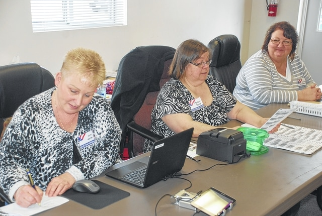 Pictured from left are poll workers Patty Martin, Monica Thomas and Darlene Hoyt Monbeck at the Mad River Township building. The trio was taking care of voters coming in during lunch hour on Tuesday.