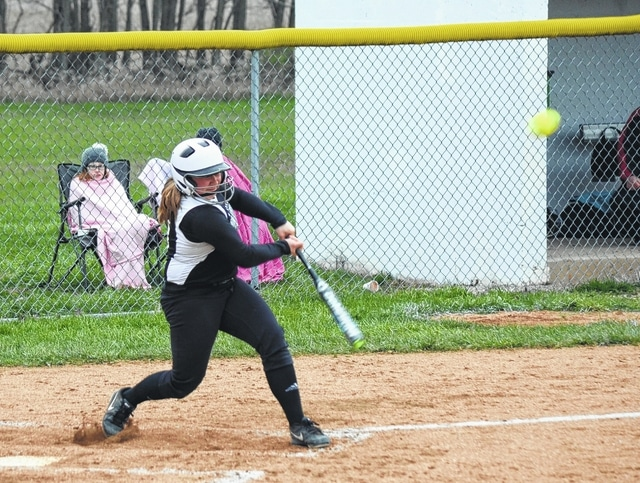 Graham's Allie Neeld smacks a double to right-center field on Monday against Indian Lake. Neeld had another double in extra innings that won the game for Graham.