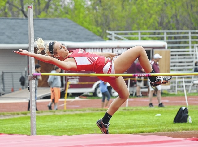Triad's Allyssa Eaton goes over the bar during the high jump competition at Urbana on Tuesday. Eaton won the event with a jump of 4-10.