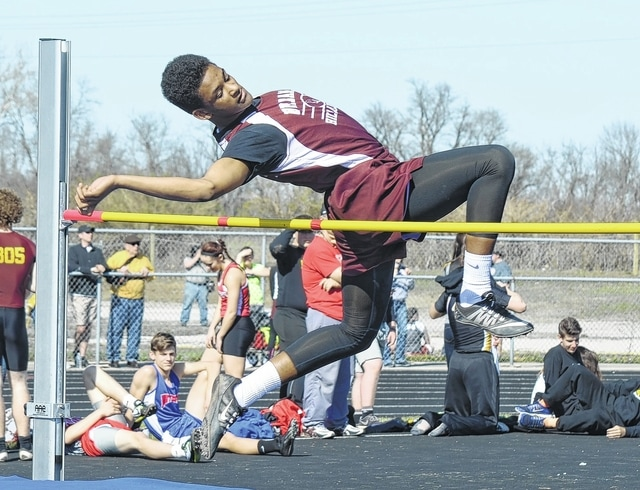 Urbana's Devin Trent launches himself over the high jump bar Friday night at the Graham Invitational.