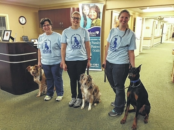 From left, at Heartland of Urbana. are the following pet-assisted therapy teams: Terry Reeder and Sassy Belle of Bellefontaine, Nikki Collins and Lancelot of West Liberty, and Jenna Reichert and Tristan of Dayton. The pet therapy teams are the first to complete testing and observation requirements under the supervision of Urbana resident Nancy Sleeper, who volunteers as a tester/observer for Alliance of Therapy Dogs. To become registered as a pet-assisted therapy team through ATD, handlers and their dogs first must complete the testing/observation program.