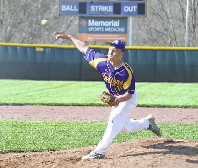 Mechanicsburg's Drew Myers delivers a pitch against Triad on Friday. The Indians and Cardinals continued the game that had been suspended from Thursday.