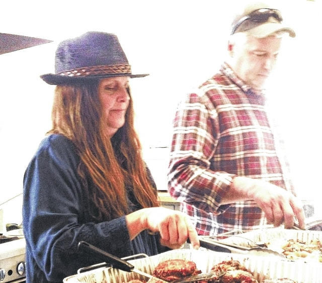 Hippie and the Farmer, Pamela Bowshier and Mark Runyan, prepare and serve the free Community Meal at the Church of the Epiphany in March.