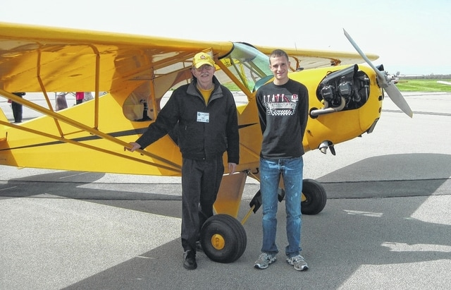 Urbana pilot Rick Rademacher, left, poses with an area youth during an Experimental Aircraft Association Chapter 9 Young Eagles Rally in 2013 at Grimes Field. Over the years, Rademacher has given free rides to 457 youths through the Young Eagles program.