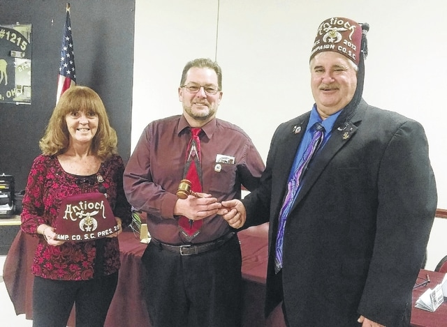 At a recent Champaign County Shrine Club meeting, Noble Steve Runkle was installed as the new Shrine Club President. Pictured from left to right are Loretta Runkle, wife of Noble Steve Runkle, and Noble Greg Burroughs presenting the gavel to Steve Runkle. Burroughs is the Immediate Past President.