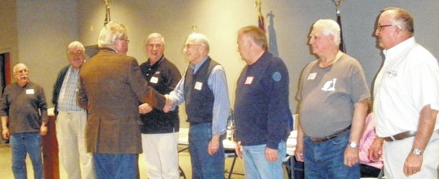 Bob Max, president of the Champaign Country Veterans Service Commission, presented lapel pins to Vietnam veterans present.
