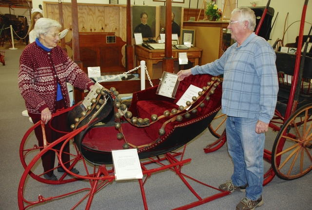 June Kiser (left) and Dick Virts check out a display at the Champaign County Historical Society in Urbana on Monday.