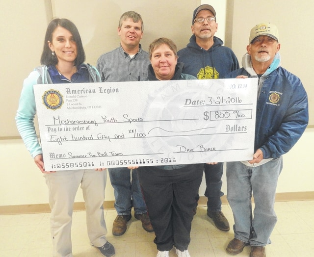 Mechanicsburg's American Legion Donald J. Cannon Post #238 is sponsoring 9 summer T-Ball, Softball and baseball teams (five in Mechanicsburg and four in North Lewisburg). Pictured accepting and presenting a check is Kristi Conley, Joey Boggs, Maria McNicol, Dave Merritt and Post Commander Dave Baker.
