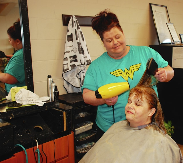 Amanda Lykins, manager of The Styling Company on Scioto Street in Urbana, dries Sharon Taylor's hair Saturday evening during a special charity event. Proceeds from the evening will help sponsor the Mandy's Cancer Avengers team during the 2016 American Cancer Society's Relay for Life on Friday, May 20 and Saturday, May 21 at the Champaign County Fairgrounds. Business was brisk during the hair charity event, which lasted from 6-11:30 p.m. and offered $10 haircuts, $25 color processes and $5 waxes. The stylists donated their time and all money for services went to Relay for Life. The event raised $200.