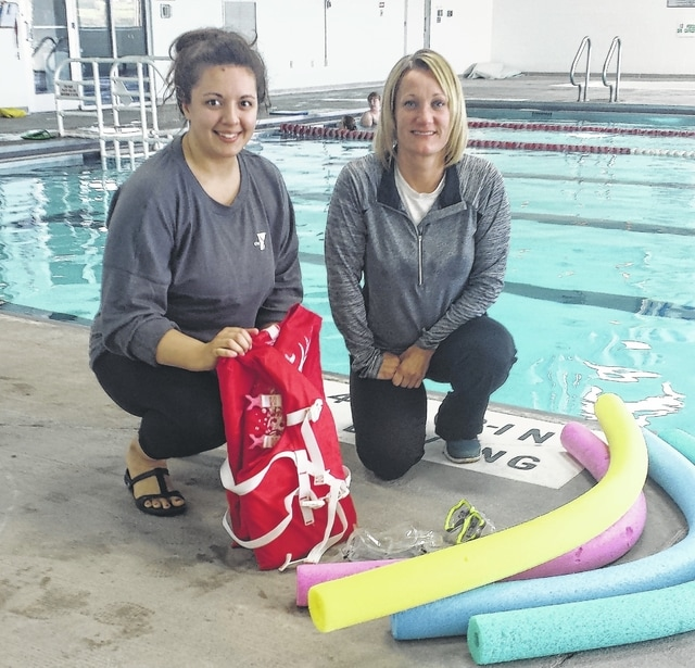 Emily Rorrer, Y aquatics director, left, and Cheryl Wade, city pool manager