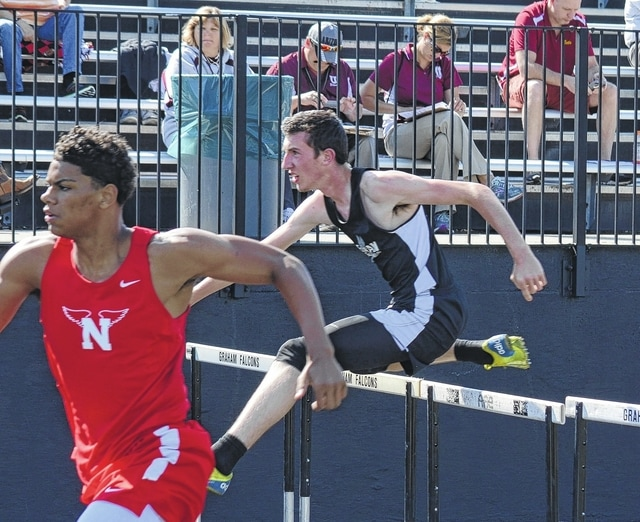 Graham's George Bugg leaps over a hurdle in the boys' 110-meter competition on Thursday at Graham.