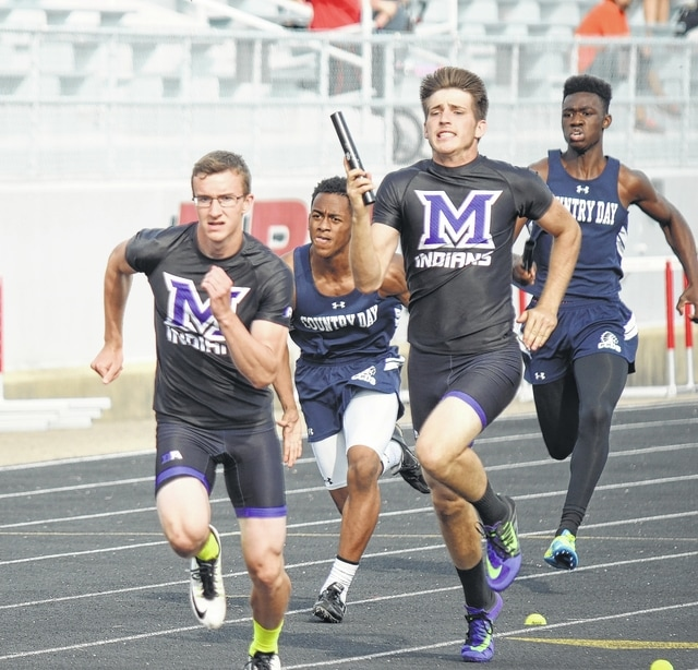 Mechanicsburg's David Harvey delivers the baton to Jared Butcher during the 4x200 relay preliminaries at the Division III regional meet in Troy.