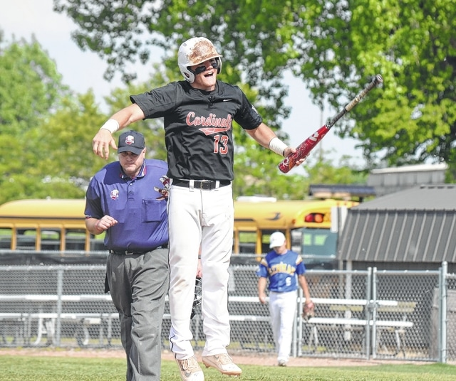 Triad's Dalton Holycross was pretty excited to score the game's first run during Friday's Division IV regional final against Lehman Catholic. Holycross sprang into the air several times before being mobbed by his teammates on the way to the dugout.