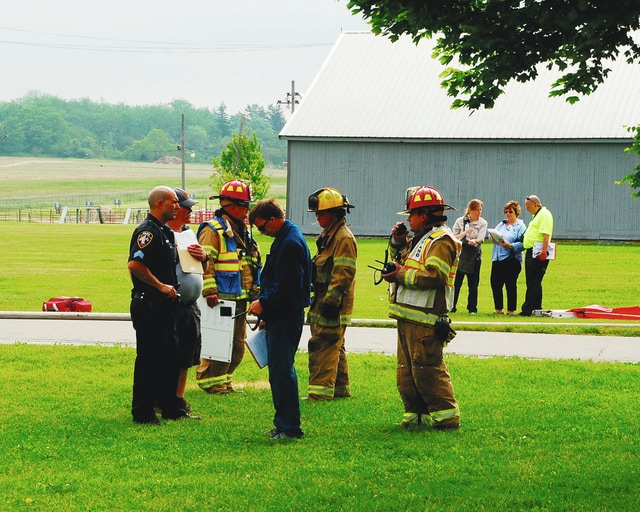 Multiple first responders and county agencies participated in a hazardous materials drill Thursday morning at the county fairgrounds. A part of the fairgrounds served as a mock setting of Monument Square. The drill involved a crash resulting in a hazardous material leaking onto the roadway and threatening waterways. The drill was coordinated by the Local Emergency Planning Committee and will be evaluated by the Ohio Emergency Management Agency.