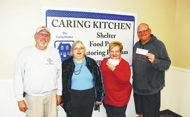 Juanita Brooks, treasurer of the Champaign County Ministerial Association, presented each of three Urbana-based food pantries with a check totaling $1,451 during a ceremony held Wednesday at the Caring Kitchen, 300 Miami St. From left are Ted Herndon, The WhereHouse director; Brooks; Marilyn Cohn, Caring Kitchen executive director; and Chris Livingston, pastor of Life Net Christian Fellowship (Stepping Stones Outreach Ministries).