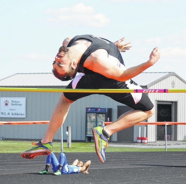 Graham's Gage Thomas contorts his body over the bar during the high jump competition at West Liberty-Salem on Friday.
