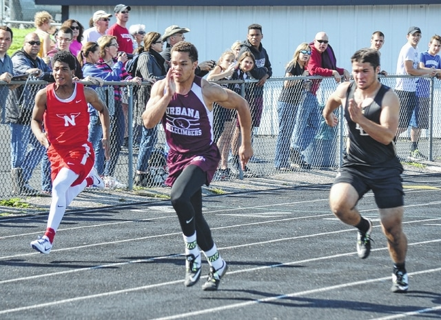 Urbana's Nick Johnson leads his flight during the Division II 100-meter dash preliminaries at Graham. Johnson went on to finish third in the finals on Saturday, qualifying for this week's regional competition.