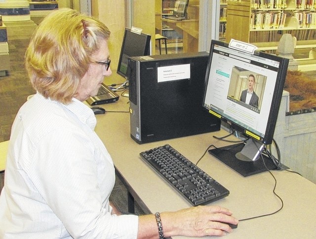 Champaign County Library Librarian Assistant Pat Eubanks demonstrates how to access Lynda.com through the library. The library is offering instructional courses through Lynda.com for members, at no charge.