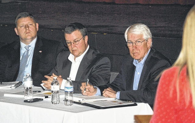 Logan County Commissioners, from left, Dustin Wickersham, Tony Core and John Bayliss listen to one of the 30-odd speakers at the Holland Theatre May 17 to encourage Logan County not to accept a payment in lieu of taxes (PILOT) from EverPower LLC for the proposed Scioto Ridge Wind Farm. EverPower plans to erect 18 wind turbines in Richland and Rushcreek townships and is asking the commissioners to accept the PILOT, rather than being taxed at existing utility rates over the next 20 years. With the exception of EverPower's Jason Dagger, none of those who addressed the commissioners were in favor of accepting the PILOT.
