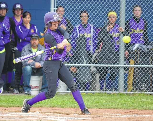 Mechanicsburg's Jessica Maddux smacks a single up the middle against Ansonia on Tuesday. Maddux was 3 for 3 at the plate to help power the Indians' offense.