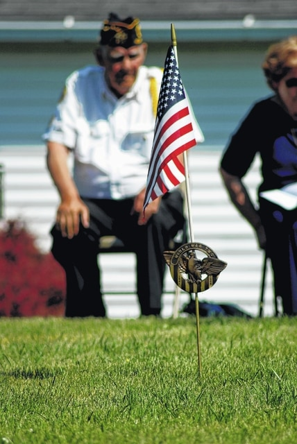 North Lewisburg held a ceremony on Memorial Day to honor the sacrifices for freedom. Boy Scouts decorated graves during the ceremony.